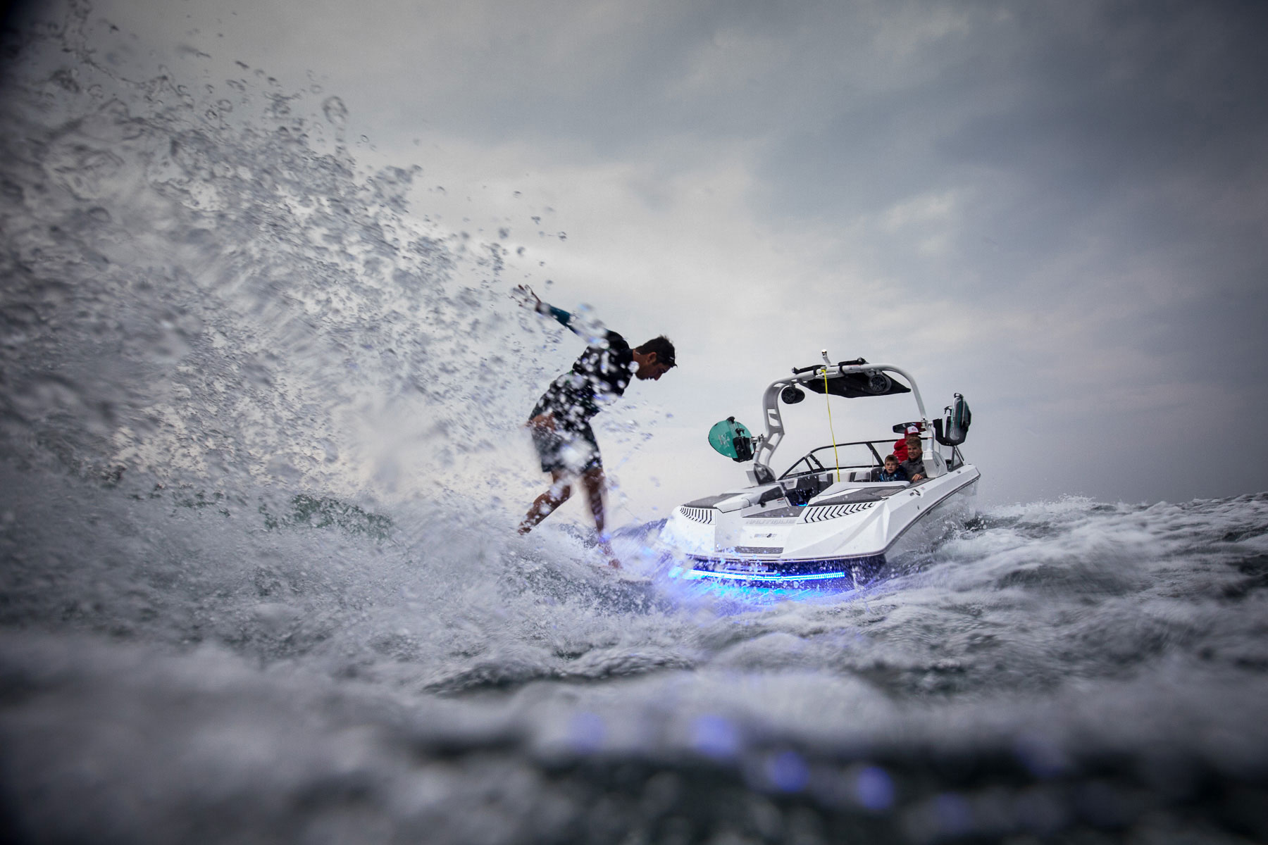 Wakesurfing behind boat with LED boat lights